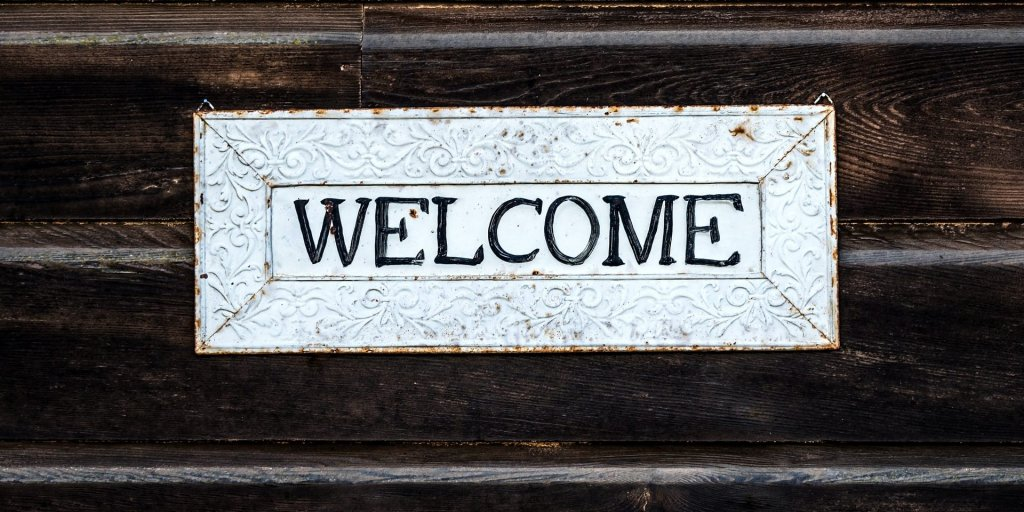 Welcome sign on wood
