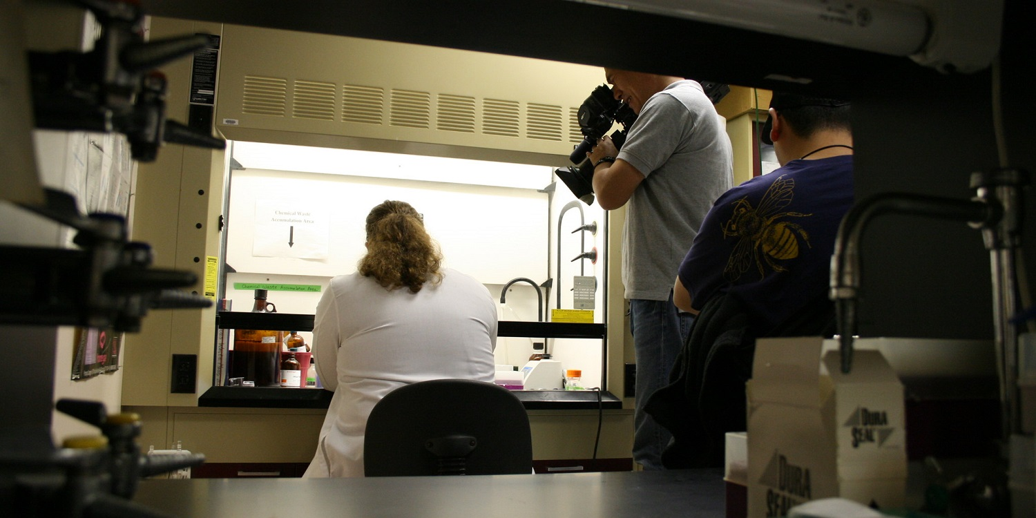 A woman researcher is being filmed