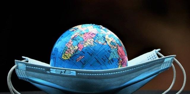 A globe in a medical mask