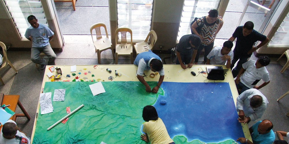 A group of people mapping area