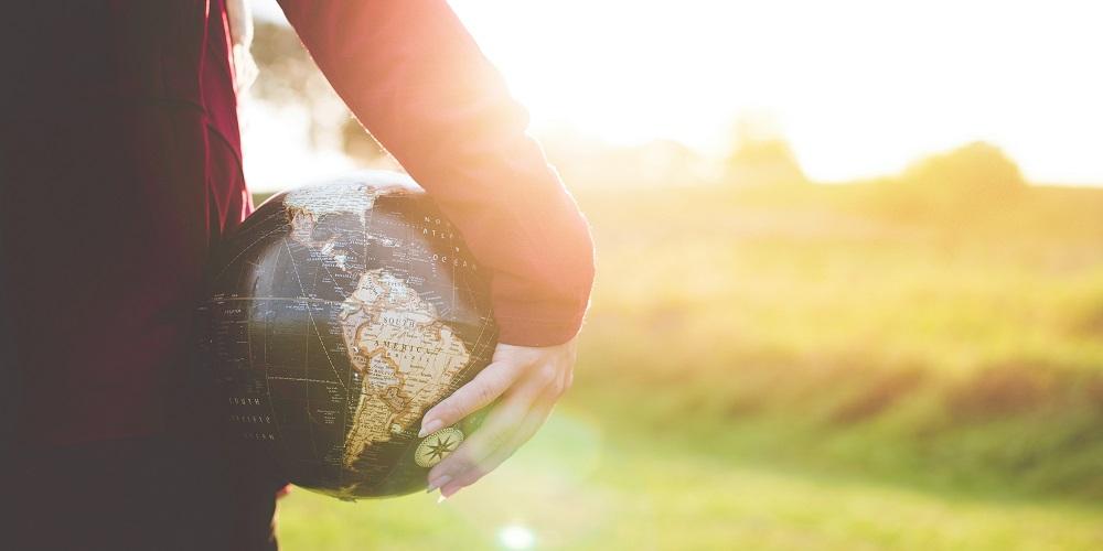 A child holding a globe