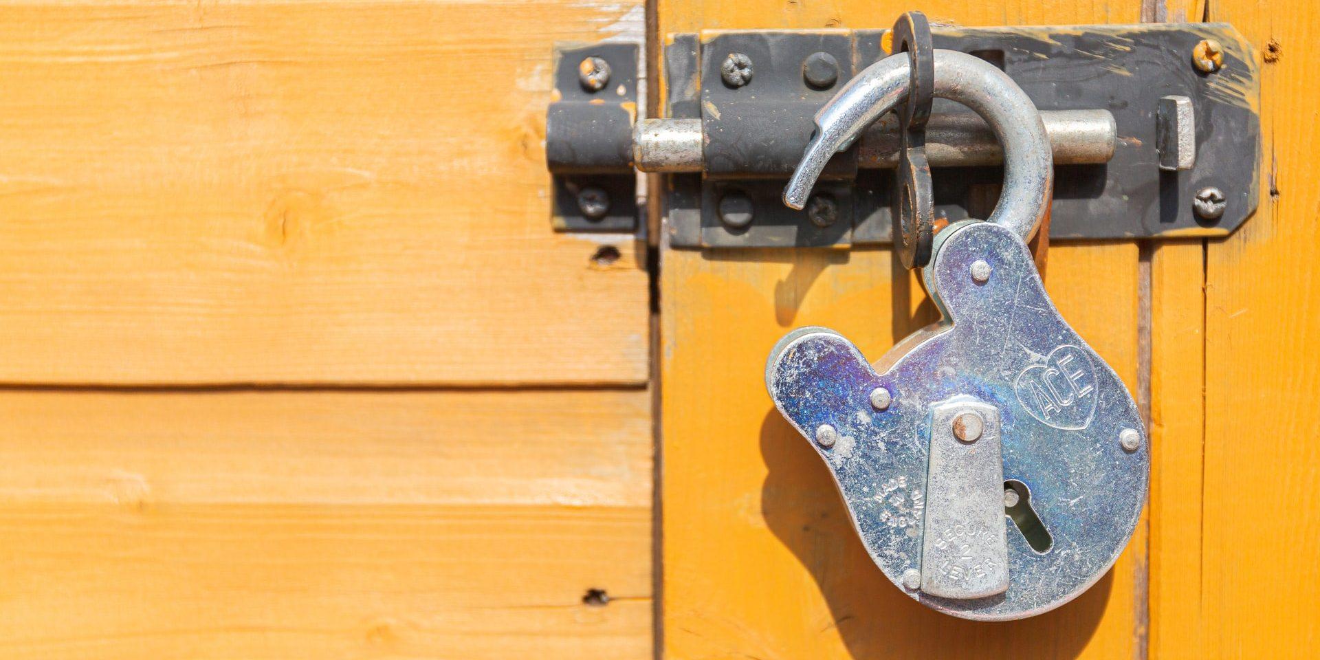 Unlocked old fashioned padlock
