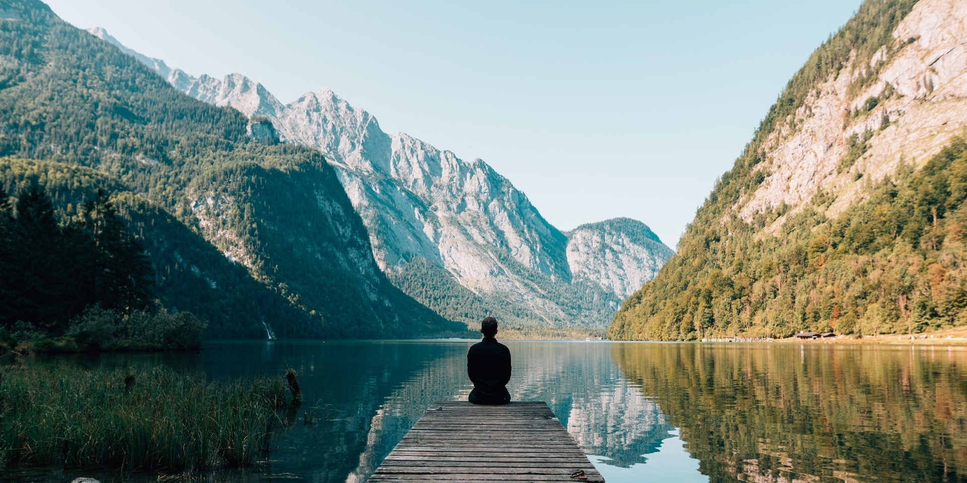 Man sitting at Königssee lake, Schönau am Königssee, Germany
