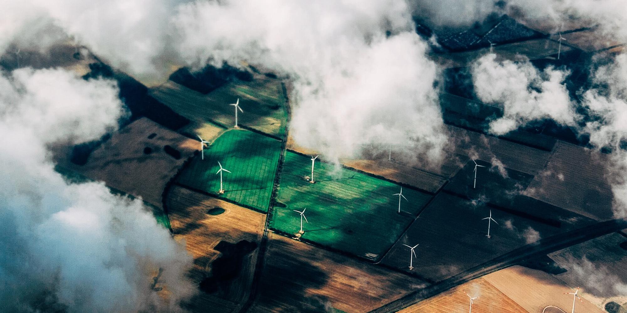 Wind turbines fields clouds